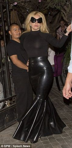 Lady Gaga flaunts her pert derriere in PVC fishtail skirt in Hollywood #dailymail