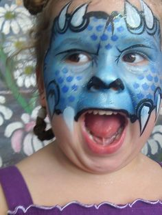 Dinosaur face paint!!!!  Too much for a quick face at the carnival... maybe just do from the top of the eyes and up