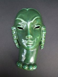 Green glazed wall mask, maker not known but probably Austrian. She measures 10 inches high