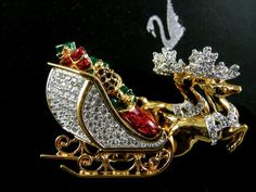 SIGNED SWAROVSKI CHRISTMAS REINDEER  SLEIGH PIN/BROOCH  NEW RETIRED