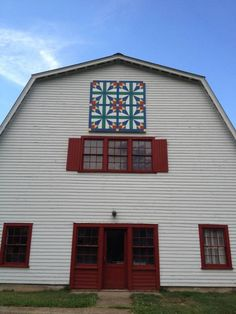 """Donna Sue Groves desired to honor her mother who sparked the creation of an """"imaginary clothesline of connecting barns decorated with quilt squares across rural America."""" In 2001 8-by-8-foot quilt murals began popping up on barns across America as the Appalachian Resource Conservation and Development Council (Appalachian RC Council) in Northeast Tennessee was established."""