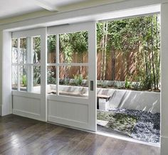 Gorgeous sliding doors open to a bright patio