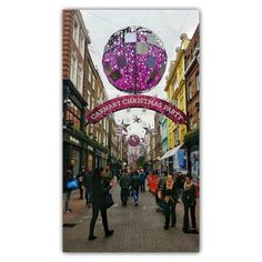 Hmm do we think the #ChristmasDecorations on #CarnabyStreet are naff or fab?