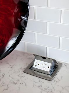 Kitchen Design Idea - Install A Pop-Up Outlet Directly Into Your Countertop