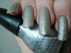 Sinful Colors Silver Solution, with glossy topcoat *click through for more Silk + Satin swatches*