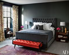 Naomi Watts and Liev Schreiber's Stunning New York City Apartment. In the master bedroom, an RH bed is grouped with Ralph Lauren Home side tables and a vintage Italian bench from Billy Cotton; the walls are clad in a Clarence House fabric, the curtains are of a Duralee floral, and an antique Moroccan rug is laid atop carpeting by Holland & Sherry.