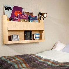 wall-mounted storage shelves intended for use in top of bunk bed; holds books and other items More