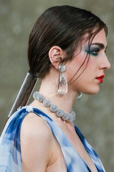 Sam McKnight complemented the look with plastic-wrapped ponytails. Models' hair had to be sucked into a vacuum to fit it into the slender transparent tubes.