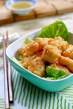 Chinese Honey Chicken: he recipe is fairly simple using chicken bites, fried, and lightly coated in a sweet honey glaze and garnished with toasted sesame seeds. #honey #chinese #chicken