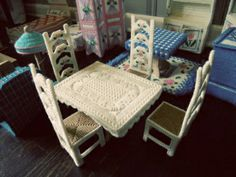 From mymclife.com   this is vintage plastic canvas Barbie furniture, but I like the chair backs and the pattern on the dining table top