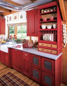 Love the red, and the open plate rack and the punch tin cabinets. for a lake cabin