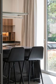 Simplicity, delicacy and functionality was the focal point when designing this 1,2 square meters Mallorcan house, open to the Mediterranean. The elegant house that has exquisite lighting features the Spine Wood Base Barstool in black leather and black lacquered wooden legs - a contrast to the surrounding interior kept in a light colour palette. Interior designer: Marta Jaudenes Technical architect: Joab Febrer Images by Antoni Perelló via Architectural Digest #fredericiafurniture #spinebarstool Technical Architect, Space Copenhagen, Wood Surface, Leather Furniture, Architectural Digest, Painting On Wood, Light Colors, Bar Stools, Dining Chairs