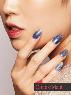 Start by applying your dark blue polish all over the nail, followed immediately by the lighter blue polish halfway up the nail and the metallic polish at the tip. Dip a brush in a quick-drying topcoat, then dip it into your glitter and paint over the polishes to help fade them into each other.