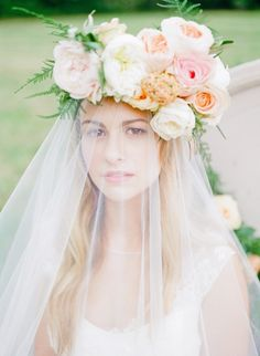 wedding hairstyle with floral detail; photo: Ashley Upchurch Photography