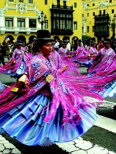 Colorful people of the world ~ Plaza De Armas Parade in Lima, Peru. Photo by Alison Kincaid