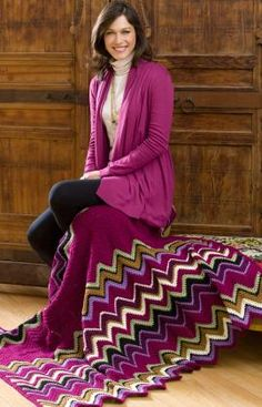Inspired by the graphic zigzag patterns in popular Missoni designs, this is a beautiful crochet afghan.