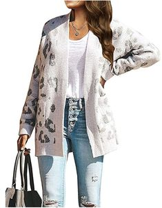 Our long-sleeve cardigan has a bold animal print that lends a fashionable twist to your look, and the Fabric construction ensures you stay comfy no matter what you're doing. As Daily Wearing, pair with basic tops/tank/shirts, Skinny pants/Jeans/Leggings, Flats/ Boots/ Sport Shoes. As Office Wear, match with Button down shirts/tops, Business Pencil Dress/Bodycon Dress, Heels/Ankle Boots/ Flats. Occasion: Spring, Fall, Party, Date, Vacation, Daily Wearing, Work, At Home, Shopping Leopard Print Cardigan, Sweater Cardigan, Trendy Clothes For Women, Black Skinnies, Long Sleeve Sweater, Sweaters, Amazon, Jeans Leggings, Print Button