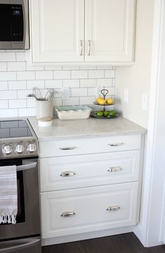 What Home Improvement Projects Taught Me About Life Kitchen Makeover with White Ikea Kitchen Cabinets, Subway Tile Backsplash and Marble Quartz Countertop - Satori Design for Living White Ikea Kitchen, Ikea Kitchen Design, Ikea Kitchen Cabinets, Kitchen Cabinet Remodel, White Cabinets, Classic Cabinets, Diy Cupboards, Kitchen Grey, Kitchen Drawers