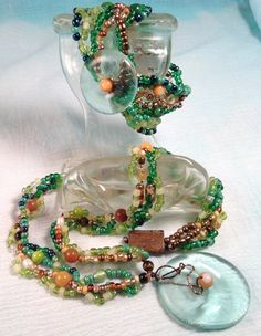 Baubles from wine bottle tops on beaded weaved necklace and bracelet