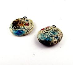 The beauty of the baud -- a set of 2 antique-looking  ceramic pendants with turquoise crackle glaze, steampunk supplies.  via Etsy.