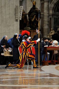 Swiss Guard kneels during Mass inside St. Peter's Basilica