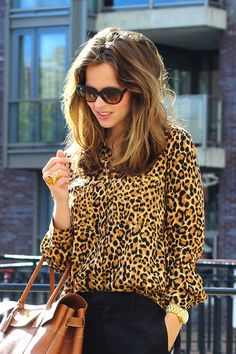 Leopard with class. Black trousers. Chestnut leather handbag. Beautiful soft waves and black sunnies. Lovely.