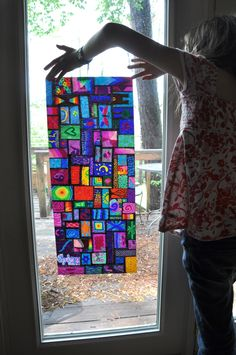 Sharpie marker on wax paper looks like stained glass. Prefect for dorm room windows to show your personality or school spirit. #dorm