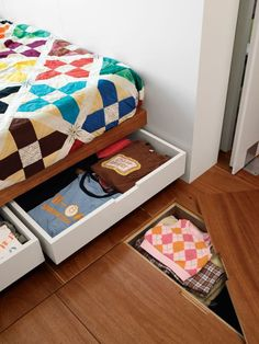 Underfloor storage. Would be great for storing blankets and off-season clothing. The stuff inside could even double as insulation.