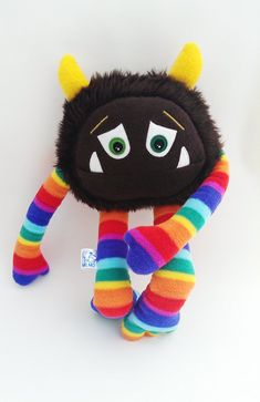 Jazzy Rainbow Floyd, a cuddly fleece and faux fur stuffed monster toy who needs a loving family to adopt him on Etsy, $66.27