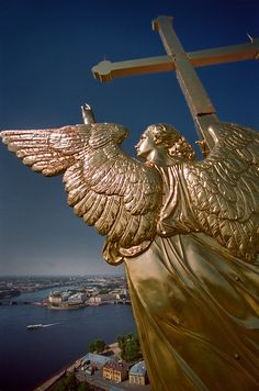 Flying angel bearing a cross, Saints Peter and Paul Cathedral, Saint Petersburg, Russia