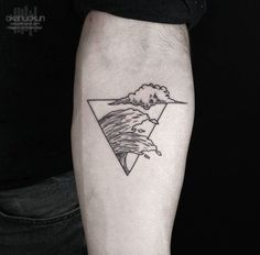 A rather cute looking Triangle Glyph Tattoo. You can see images of the clouds and the waves almost meeting as they are enclosed within the triangle symbol. It's small, very neat looking and a wonderful design.