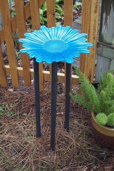 Great homemade birdbath with 3 dowel rods and a dollar store dish.  Adds great color too and easy to clean.