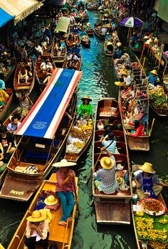 Damnoen Saduak Floating Market, Thailand. The colours and the hats are things that always seem Thai