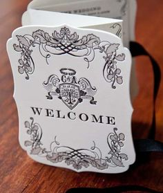die-cut z-fold welcome booklet with custom designed crest