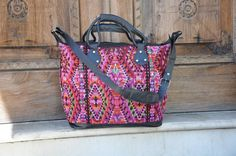 Pink Garden Traveling Bag by Tienditaboutique on Etsy This beautiful traveling bag has pink flowers with its green leafs around it for a gorgeous color pallet. With beautiful black leather to complete the look into perfection.