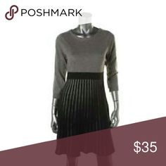 Calvin Klein grey sweater dress with pleated skirt Monochromatic gray dress with scoop neck and pleats, at or just above the knee length with 3/4 length sleeves Calvin Klein Dresses Long Sleeve