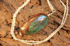 Hey, diesen tollen Etsy-Artikel fand ich bei https://www.etsy.com/de/listing/481351466/necklace-raku-ceramic-with-925-sterling