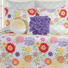 """Outfit your master suite or guest room in garden-chic style with this lovely cotton quilt, featuring a multicolor floral motif.    Product: QuiltConstruction Material: CottonColor: Purple, orange and yellowFeatures: Floral motifDimensions: Twin: 86"""" x 68""""Full/Queen: 90"""" x 92""""King: 92"""" x 108""""  Note: Price is for quilt only, pillows and shams pictured are not included Cleaning and Care: Machine wash cold on gentle cycle and remove promptly. Do not bleach. Line dry."""