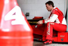 Kevin Harvick Photos Photos - Kevin Harvick, driver of the #4 Budweiser/Jimmy John's Chevrolet, sits in the garage area during practice for the NASCAR Sprint Cup Series Ford EcoBoost 400 at Homestead-Miami Speedway on November 20, 2015 in Homestead, Florida. - Homestead-Miami Speedway - Day 1