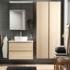 IKEA A bathroom with grey-brown tiles and white stained oak effect wash-stand and high cabinet. Combined with a white wash-basin and a wall cabinet with mirror doors. Ikea Bathroom, Bathroom Renos, Bathroom Furniture, Bathroom Storage, Modern Bathroom, Small Bathroom, Bathrooms, Bathroom Images, Bathroom Closet