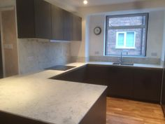 finally our new kitchen near completion! Siematic Umbra and gorgeous solid work surfaces.