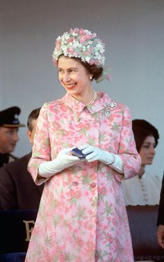 The Queen 1967  The Queen wearing a pink patterened coat and floral appliqué hat, during a visit to Malta.