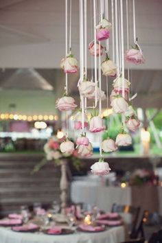 Hanging roses - fun way to make a statement at the entrance, behind the cake or head table, and at the ceremony. Works great with other flowers, too!   #wedding #decor #flowers