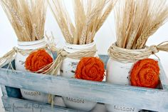 Easy festive Fall Mason Jar Centerpieces {and how to make burlap rosettes}. Chalk painted mason jars with burlap rosettes! Fall Mason Jars, Mason Jar Crafts, Mason Jar Diy, Burlap Rosettes, Burlap Flowers, Crate Decor, Distressed Mason Jars, Thanksgiving Diy, Thanksgiving Tablescapes