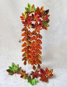 tsumami kanzashi is the Japanese art of making flowers via fabric origami