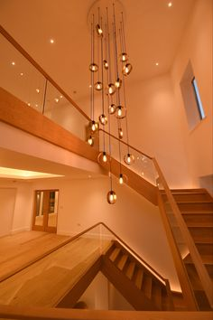 custom version of the beautiful 'HALO' ceiling pendant was specified for the atrium of this private residence. A prime example of a statement piece of lighting being used perfectly to create stunning interior effect. Ceiling Pendant, Ceiling Lights, Bespoke Design, Atrium, Hospitality, Home Projects, Track Lighting, Halo, Create