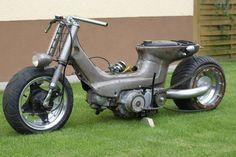 Raw metal Honda Cub custom with single-sided swingarm and radial-mounted rear sprocket