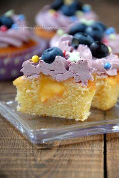 Lemon Cupcakes with Lemon Curd and Blackberries Meringue Frosting