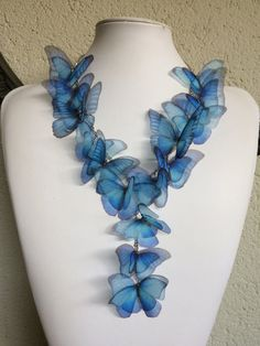 A special necklace, completely handmade with silk organza Morpho Blue butterflies. I chose butterfly images one by one, from real pictures and vintage illustrations. Then I printed them on high quality silk organza, handcut, sealed and fixed on a chain. Feminine.. ethereal..