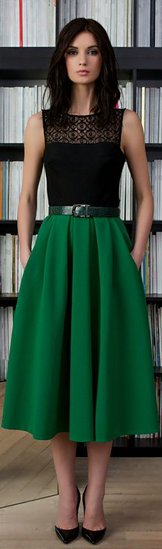 Black lace sleeveless bust and emerald green long skirt with green snakeskin belt